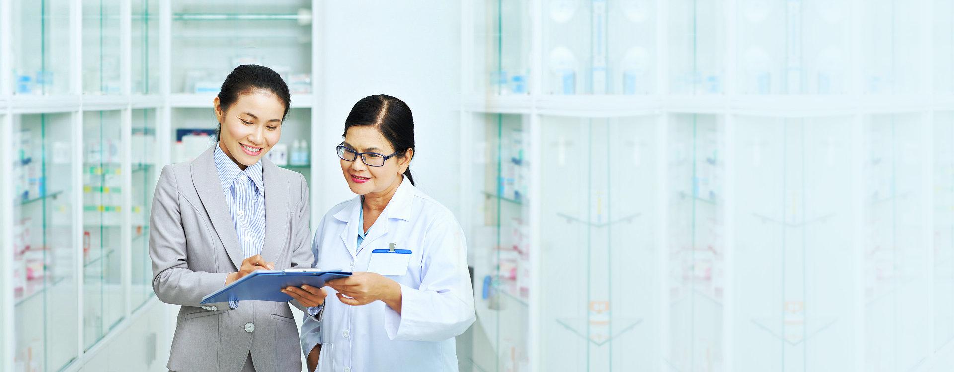 female customer talking to a pharmacist
